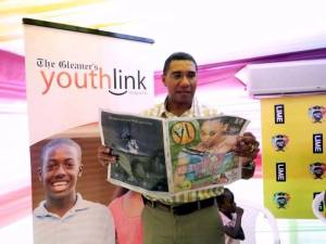 Former Prime Minister of Ja and Opposition Leader, the Hon. Andrew Holness at the 2013 LIME 'Skool Aid' event with Abenah Adelaide Design Youthlink feature in hand.